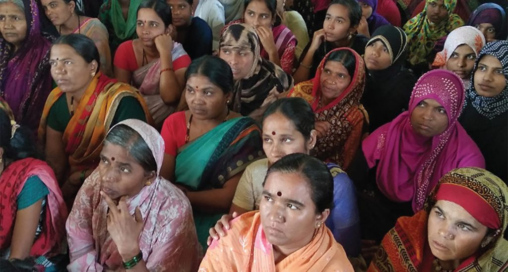 Women who have been empowered gather for a meeting in Ukkali village.