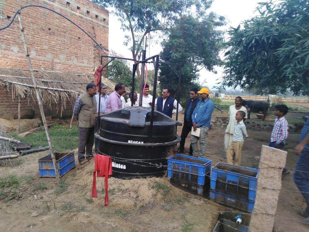 Officers of Agriculture department and project team interact with biogas farmer ©ICRISAT