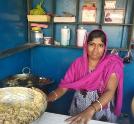 A beneficiary from the project has set up her own store to sell stationary and snacks.